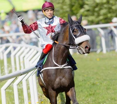 jockey holding the whip