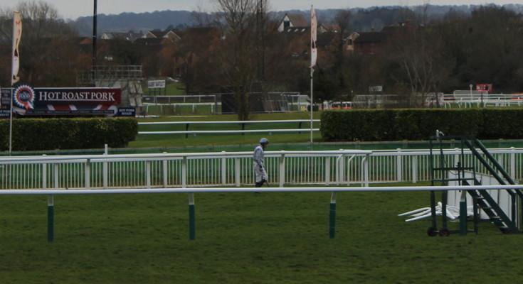 jockey on the long walk back following a fall