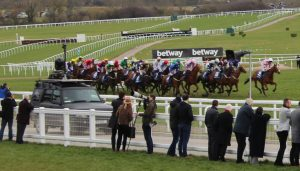 tv car following horses up the hill at cheltenham