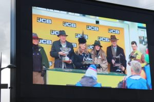 jcb triumph hurdle winners being given prizes
